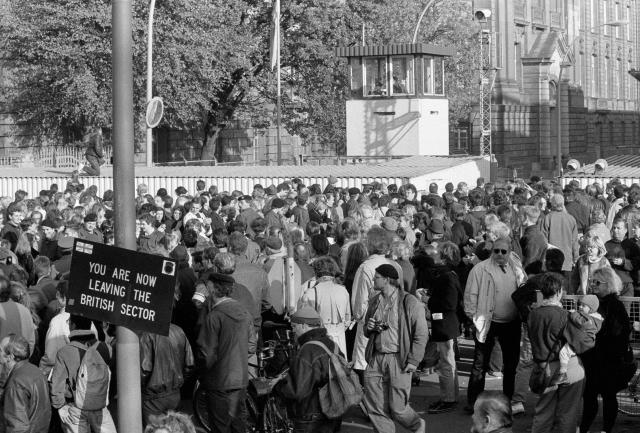 West Berlin citizens welcome East Germans who passed the Invalidenstrasse border checkpoint on Nov. 9, 1989. (Photo: Fabrizio Bensch/Reuters)