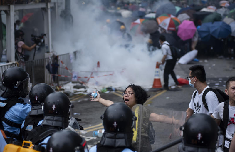 ADMIRALTY, HONG KONG - 2019/06/12: A protester tries desperately to convince police officers to stop using force against them during the demonstration. Thousands of protesters occupied the roads near the Legislative Council Complex in Hong Kong to demand to government to withdraw extradition bill. The Hong Kong government has refused to withdraw or delay putting forward the bill after tens of thousands of people marched against it on Sunday. (Photo by Miguel Candela/SOPA Images/LightRocket via Getty Images)