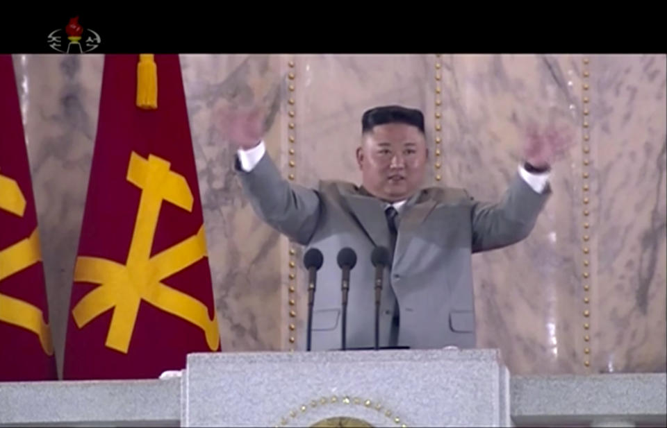 In this image made from video broadcasted by North Korea's KRT on Saturday, Oct. 10, 2020, North Korean leader Kim Jong Un waves during a ceremony to celebrate the 75th anniversary of the country's ruling party in Pyongyang.(KRT via AP)