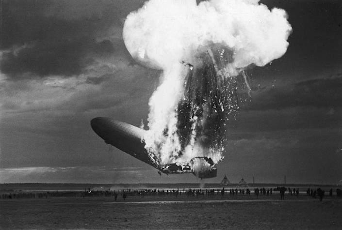 <p>The German-designed and built passenger airship the Hindenburg (LZ-129) catches fire as it attempts to land in Lakehurst, New Jersey, following it's first cross-ocean flight of the year, May 6, 1937. The lighter-than-air craft had made more than 30 successful cross-ocean trips previously, but the disaster, in which 35 of the 90-odd passengers and crew members died, effectively ended this type of commerical air travel. (Arthur Cofod/Pictures Inc./The LIFE Picture Collection/Getty Images) </p>