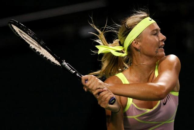 FILE PHOTO: Maria Sharapova of Russia returns the ball to Agnieszka Radwanska of Poland during their semi-final match at the Pan Pacific Open in Tokyo