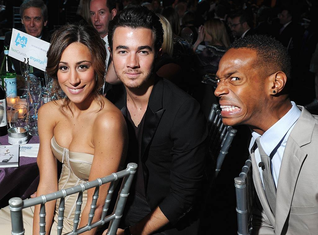 """Kevin Jonas and wife Danielle remained unfazed by comic Marlon Wayans' wacky antics at the neighboring table. The happy couple is squeezing in all the date nights they can, as the pitter-patter of little feet might not be very far off. """"I cannot wait to be a mom and I know [Kevin]'s pushing to be a dad,"""" Danielle told <i>Us Weekly</i> last month. Michael Loccisano/<a href=""""http://www.gettyimages.com/"""" target=""""new"""">GettyImages.com</a> - June 13, 2011"""