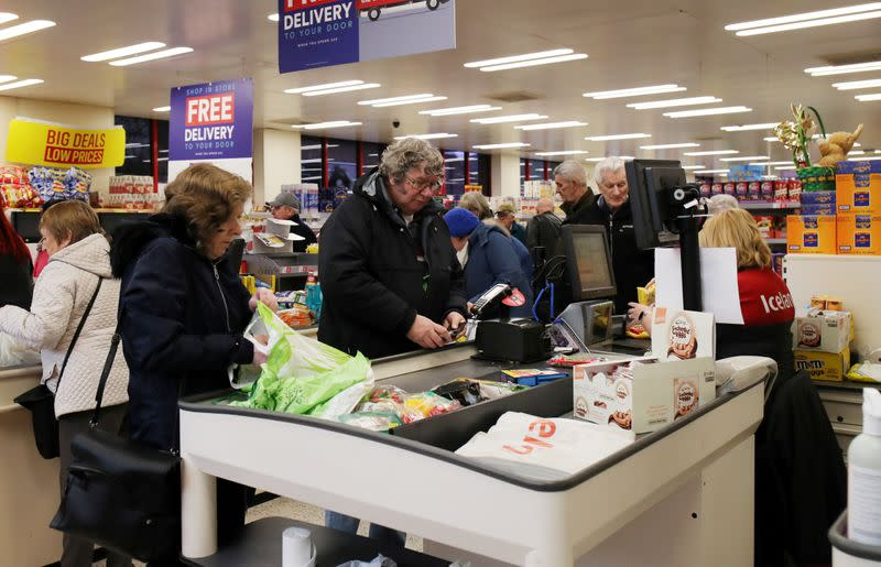 FILE PHOTO: People at an Iceland store in Northwich after opening one hour early