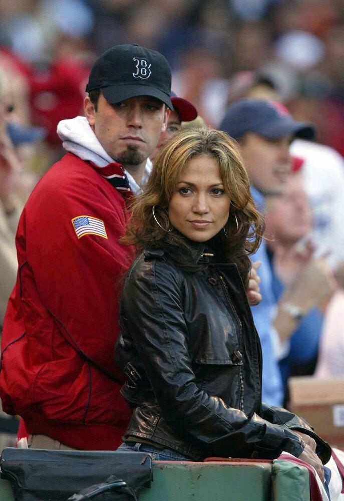 Actress/singer Jennifer Lopez wears a black leather jacket with boyfriend Ben Affleck watching the New York Yankees.