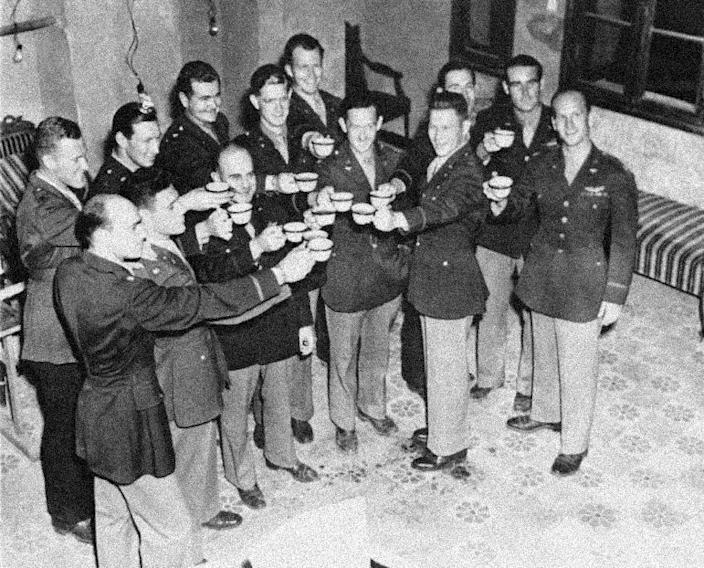 FILE - In this July 14, 1943 file photo, Maj. Gen. James Doolittle, (third from left, front row) who led the air raid on Japan, April 18, 1942, and some of the men who flew with him drink a champagne toast from coffee cups during a reunion in North Africa on the first anniversary of the flight. Flyers are left to right front row: Maj. William Bower, Ravenna, OH; Maj. Travis Hoover, Arlington, Calif.; Maj. Gen. Doolittle Lt. Col. Harvey Hinman, San Francisco, (not one of raiders); Capt. Neston C. Daniel, Plaquemine, LA., Back row left to right: Capt. Howard A. Sessler of Arlington, Mass., who brought the picture to this country; Capt. William R. Pound, Jr., Kent Homes VA.; Maj. Rodney R. Wilder, Taylor, Tex.; Capt. James M. Arker, Livingston, Tex., Maj. Charles R. Greening, Tacoma, Wash., Maj. Joseph Klein, Paradise, Tex.; Capt. Griffith P. William, San. Diego, Calif., and Capt. Thomas C. Griffin, Chicago, Ill. (AP Photo)
