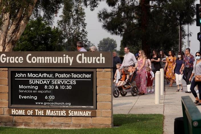 People head to Sunday service at Grace Community Church in Sun Valley on Sept. 13. The church has regularly held packed morning services, defying a court order directing it to refrain from holding indoor services due to the COVID-19 pandemic. (Genaro Molina / Los Angeles Times)
