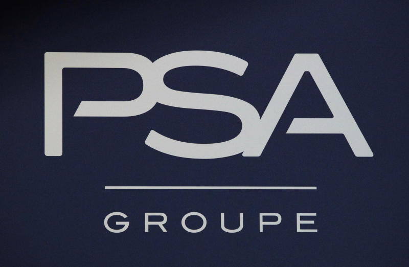 FILE - In this Thursday, Feb. 23, 2017, file photo, the logo of PSA Group is pictured in Paris. Italian-American carmaker Fiat Chrysler Automobiles on Wednesday OCT.30, 2019 confirmed that it is in talks with French rival PSA Peugeot, its second bid this year to reshape the global auto industry facing huge challenges with the transition to electric and autonomous vehicles. (AP Photo/Christophe Ena, File)
