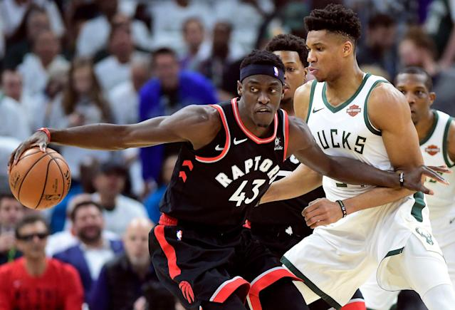 Toronto Raptors forward Pascal Siakam (43) tries to keep Milwaukee Bucks forward Giannis Antetokounmpo (34) at bay during the first half in Game 1 of the NBA basketball playoffs Eastern Conference final in Milwaukee on Wednesday, May 15, 2019. (Frank Gunn/The Canadian Press via AP)