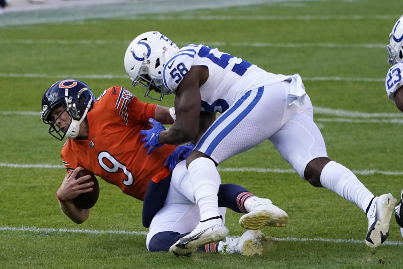Chicago Bears quarterback Nick Foles (9) is tackled by Indianapolis Colts' Bobby Okereke (58). (AP Photo/Charles Rex Arbogast)