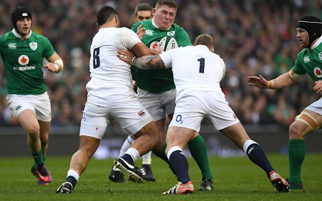 <span>Tadhg Furlong of Ireland is tackled by Billy Vunipola and Joe Marler of England</span>