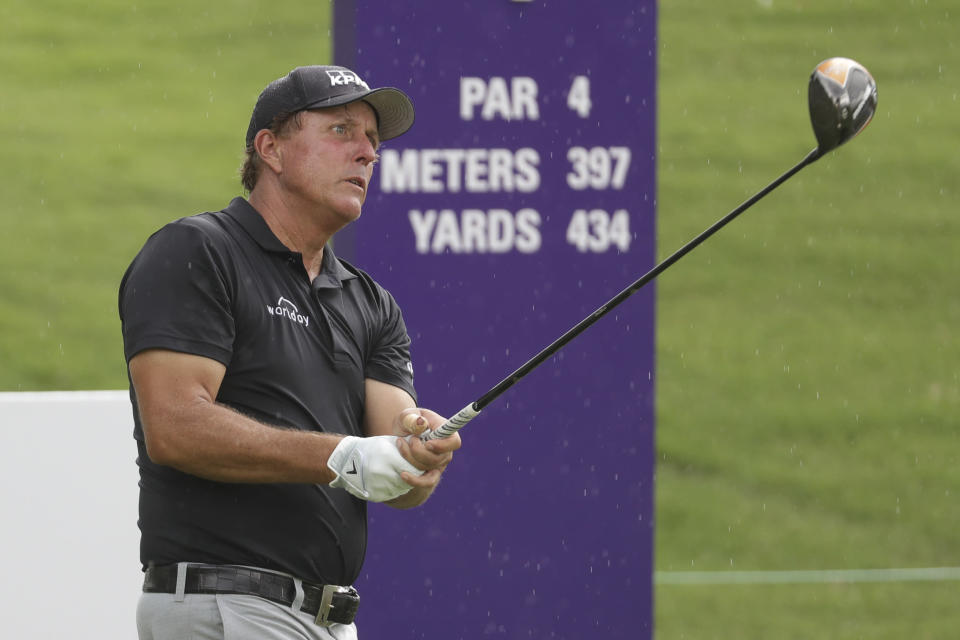 Phil Mickelson fits from the first tee during a practice round at the World Golf Championships-FedEx St. Jude Invitational Wednesday, July 29, 2020, in Memphis, Tenn. (AP Photo/Mark Humphrey)
