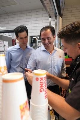 (L to R): Daniel Schwartz (Executive Chairman of RBI and co-Chairman of RBI's Board of Directors) and Jose Cil (CEO of RBI) meet with a Team Member at a Burger King restaurant in South Beach, Miami. (CNW Group/Restaurant Brands International Inc.)