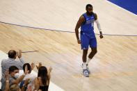 Dallas Mavericks forward Tim Hardaway Jr. (11) reacts to a three-point basket against the Los Angeles Clippers in the first half during Game 6 of an NBA basketball first-round playoff series in Dallas, Friday, June 4, 2021. (AP Photo/Michael Ainsworth)