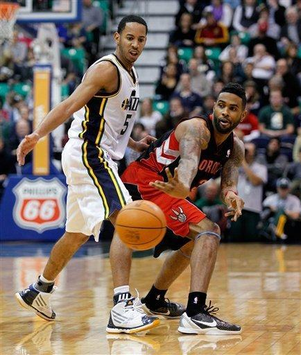 Toronto Raptors forward Gary Forbes, right, makes a pass as Utah Jazz guard Devin Harris, left, guards during the first half of their NBA basketball game in Salt Lake City, Wednesday, Jan. 25, 2012. (AP Photo/Steve C. Wilson)