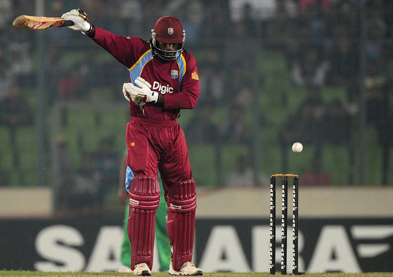 West Indies cricketer Chris Gayle plays a shot during the third one day international cricket match between Bangladesh and the West Indies at The Sher-e-Bangla National Cricket Stadium in Dhaka on December 5, 2012. AFP PHOTO/ Munir uz ZAMAN