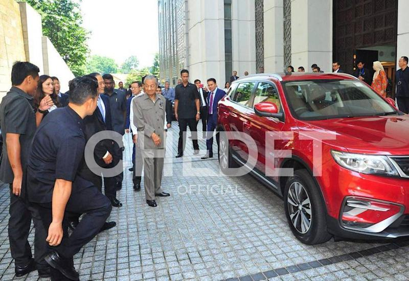 Dr Mahathir checks out the new Proton SUV. — Picture via Facebook/TunDrMahathir