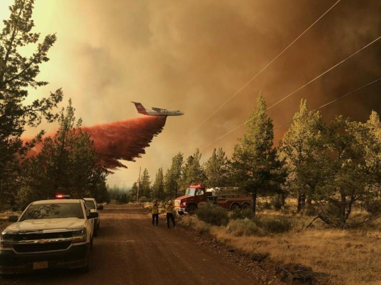 A firefighting tanker drops a retardant over the Grandview fire near Sisters, Oregon on July 11, 2021