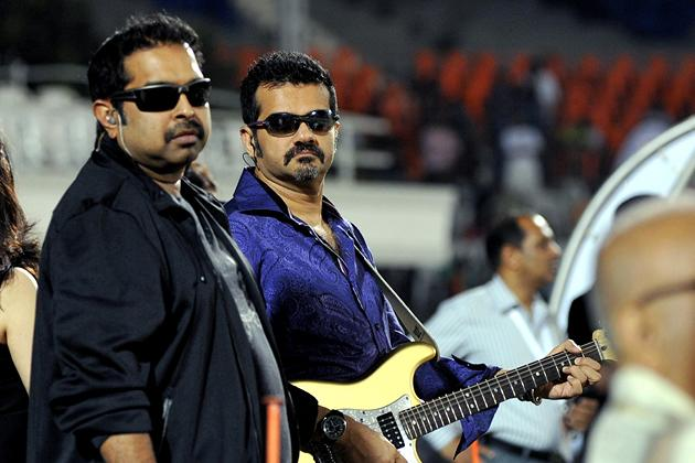 Indian Bollywood musicians and singers Shankar Mahadevan (L) and Ehsaan Noorani prepare to perform during the grand opening ceremony of the Toyota University Cricket Championship (TUCC) first match of the season in Mumbai on February 23, 2013.  AFP PHOTO        (Photo credit should read STR/AFP/Getty Images)