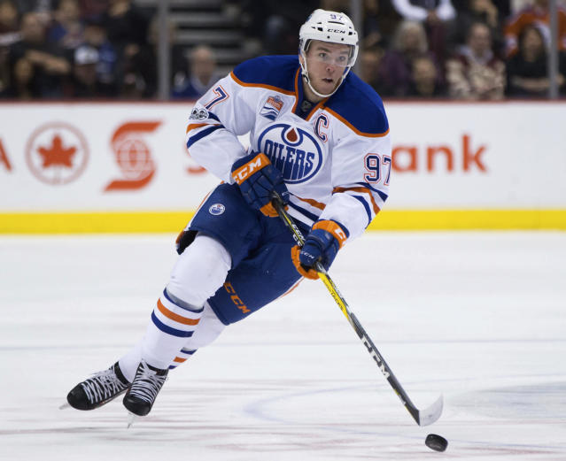 "Anyone who lands  <a class=""link rapid-noclick-resp"" href=""/nhl/teams/edm/"" data-ylk=""slk:Edmonton Oilers"">Edmonton Oilers</a> star <a class=""link rapid-noclick-resp"" href=""/nhl/players/6743/"" data-ylk=""slk:Connor McDavid"">Connor McDavid</a> in fantasy drafts will have a building block toward a championship squad. (Darryl Dyck/The Canadian Press via AP, File)"