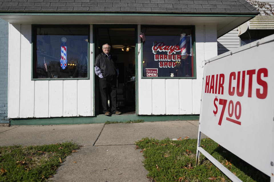 Ray Nicoson stands at the entrance of his barber shop, Wednesday, Nov. 11, 2020, in Terre Haute, Ind. Indiana's Vigo County had been America's more reliable presidential bellwether, voting in line with the rest of the nation since 1956. But that winning streak ended this year, as it did for nearly all the country's bellwethers, most of them blue-collar, overwhelmingly white communities in the Rust Belt. (AP Photo/Darron Cummings)