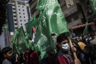 Palestinians hold Hamas movement green flags attend a protest in solidarity with Muslim worshippers in Jerusalem, in Gaza City, Friday, April. 23, 2021. (AP Photo/Khalil Hamra)