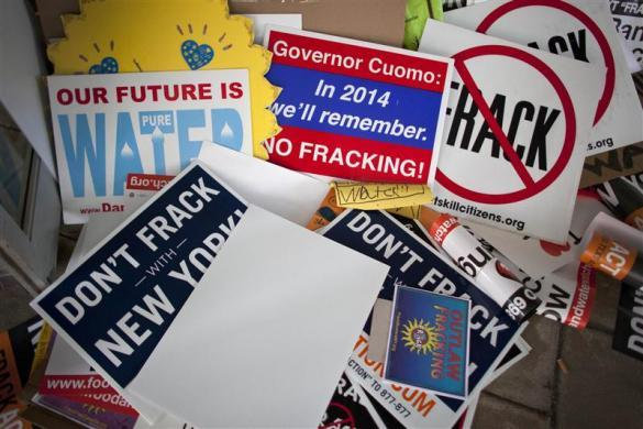 Signs protesting against hydraulic fracturing are seen outside the Tribeca Performing Arts Center, Borough of Manhattan Community College in New York November 30, 2011.