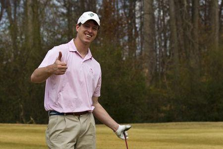 An undated handout family photo shows Witner Milner giving a thumbs up at a golf course. Milner, 25, died in the family's backyard pool in Atlanta in 2011 while breath holding to train for spear fishing. REUTERS/Hicks Milner/Handout