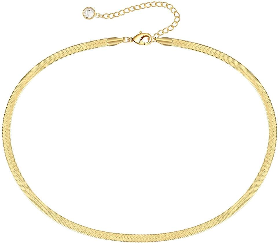 <p>This <span>Dainty Gold Thick Snake Choker</span> ($11) is perfect for layering and a stunning staple piece. </p>
