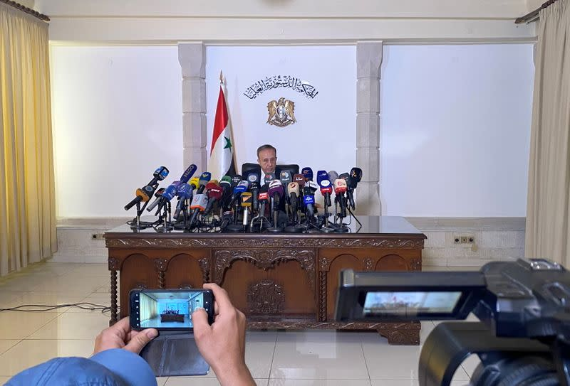 Head of the higher constitutional court, Jihad Al Laham, speaks during a news conference in Damascus
