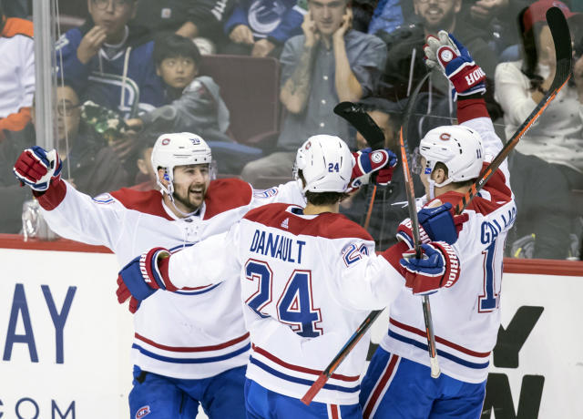 Montreal Canadiens' Tomas Tatar, left, of Slovakia, celebrates his goal with teammates Phillip Danault and Brendan Gallagher against the Vancouver Canucks during the second period of an NHL hockey game in Vancouver, British Columbia, Saturday, Nov. 17, 2018. (Darryl Dyck/The Canadian Press via AP)