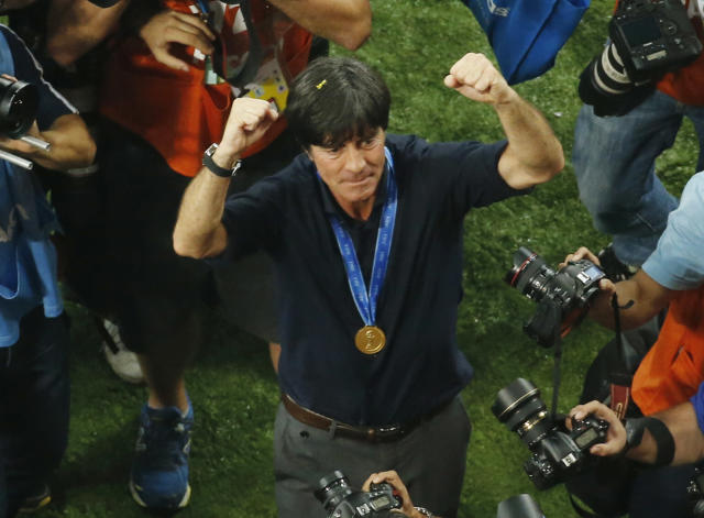Germany's head coach Joachim Loew celebrates after winning the World Cup final soccer match between Germany and Argentina at the Maracana Stadium in Rio de Janeiro, Brazil, Sunday, July 13, 2014. Mario Goetze volleyed in the winning goal in extra time to give Germany its fourth World Cup title with a 1-0 victory over Argentina on Sunday. (AP Photo/Fabrizio Bensch, Pool)
