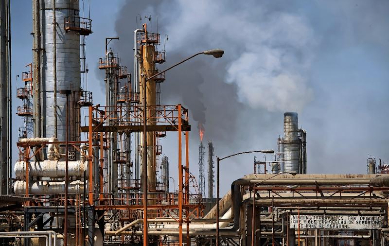 Mexico's government said it will invest $23 billion to modernize its refineries while sharply slashing greenhouse gas emissions (AFP Photo/Omar Torres)