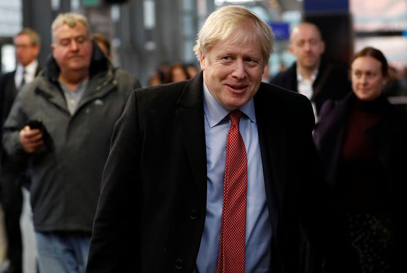 Britain's Prime Minister Boris Johnson arrives on the platform to board a train in London