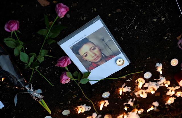 <p>Candles and flowers are left beside a photo of a victim of the gay nightclub mass shooting in Orlando, at St Anne's Church in the Soho district of London, Britain June 13, 2016. REUTERS/Dylan Martinez </p>