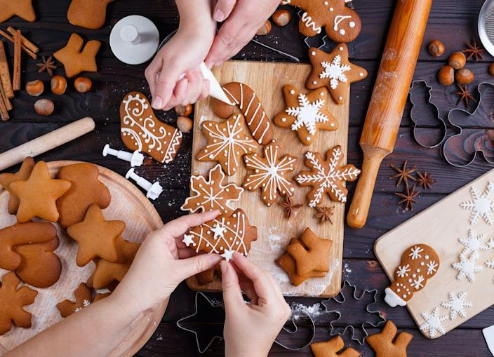 "<span class=""caption"">Working together on a once-a-year project feels festive and special.</span> <span class=""attribution""><a class=""link rapid-noclick-resp"" href=""https://www.shutterstock.com/image-photo/christmas-gingerbread-making-friends-decorating-freshly-747353851"" rel=""nofollow noopener"" target=""_blank"" data-ylk=""slk:Flotsam/Shutterstock.com"">Flotsam/Shutterstock.com</a></span>"