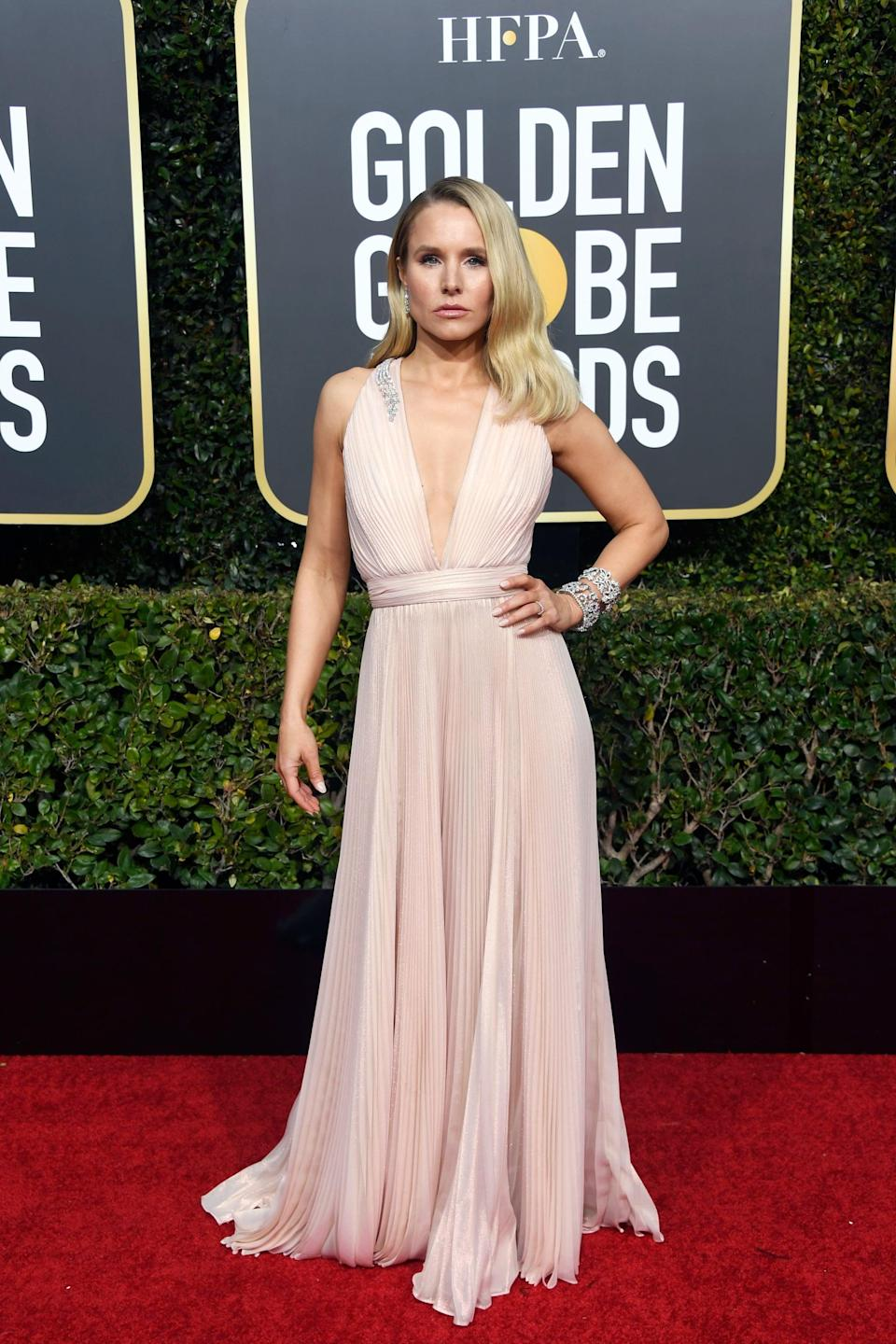<p>Wearing a Zuhair Murad dress with Harry Winston jewels and Brian Atwood shoes.</p>