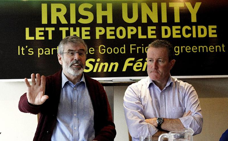 Sinn Fein President Gerry Adams, left, and party colleague Conor Murphy, speak to the media and party members in Dundalk, Ireland, Friday, Feb. 8, 2013. The leader of the Irish nationalist Sinn Fein party, has appealed to IRA splinter groups to stop their violence and to support his campaign for a vote in Northern Ireland on uniting the island.Adams, a reputed former Irish Republican Army commander, said Friday that sporadic attacks by small IRA factions make it harder to build public support for uniting Northern Ireland with the Republic of Ireland, the traditional Irish nationalist goal. (AP Photo/Peter Morrison)