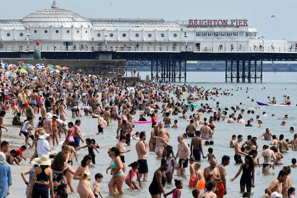 People enjoy the sunny weather on the beach, amid the coronavirus disease (COVID-19) outbreak, in Brighton, Britain August 8, 2020. REUTERS/Toby Melville     TPX IMAGES OF THE DAY
