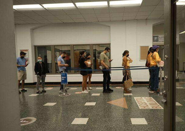 PHOTO: Bellevue Hospital employees wait on line to receive vaccine on the first day of the NYC Health and Hospitals COVID-19 vaccination mandate for all public hospital employees, in New York, Aug. 2, 2021. (Edna Leshowitz/ZUMA Wire via Newscom)