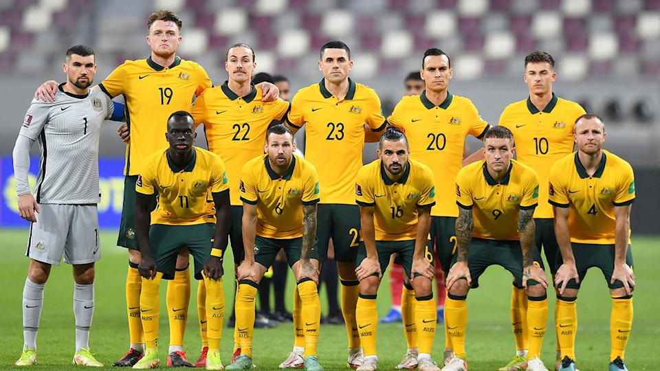 Pictured here, the Socceroos' squad poses for a photo before a World Cup qualifying game.