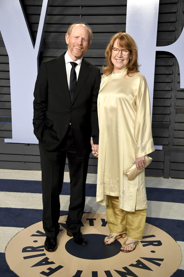 <p>The director was accompanied by his wife Cheryl, who wore a yellow ensemble. (Photo: Evan Agostini/Invision/AP) </p>