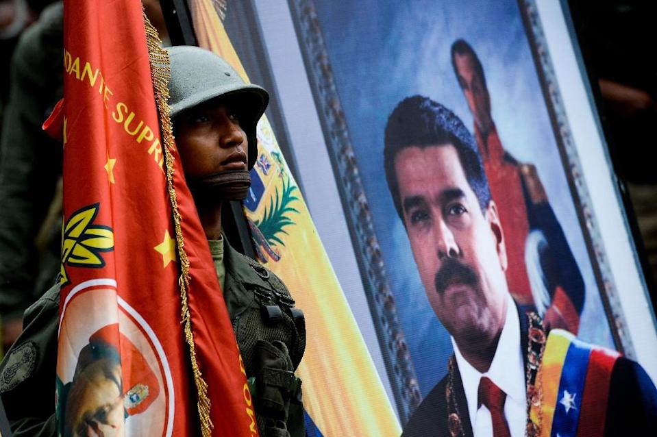 Maduro joined his army top brass at a military exercise near the northern city of Maracay, where he reminded them of their obligation to defend the country (AFP Photo/FEDERICO PARRA)