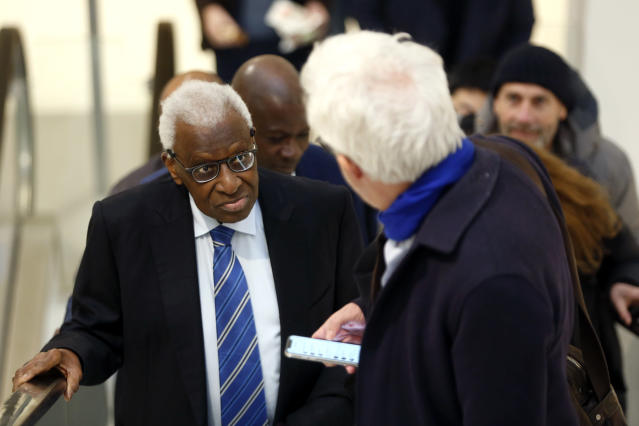 CAPTION CORRECTS SPELLING OF SURNAME Former president of the IAAF (International Association of Athletics Federations) Lamine Diack, left, arrives at the Paris courthouse, Monday, Jan. 13, 2020. One of the biggest sports corruption cases to reach court is being heard in Paris from Monday, with explosive allegations of a massive doping cover-up at the top of track and field. (AP Photo/Thibault Camus)