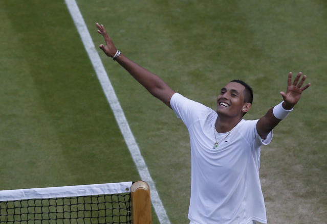 Nick Kyrgios of Australia celebrates defeating Rafael Nadal of Spain in their men's singles match on Centre Court at the All England Lawn Tennis Championships in Wimbledon, London, Tuesday, July 1, 2014. (AP Photo/Sang Tan)