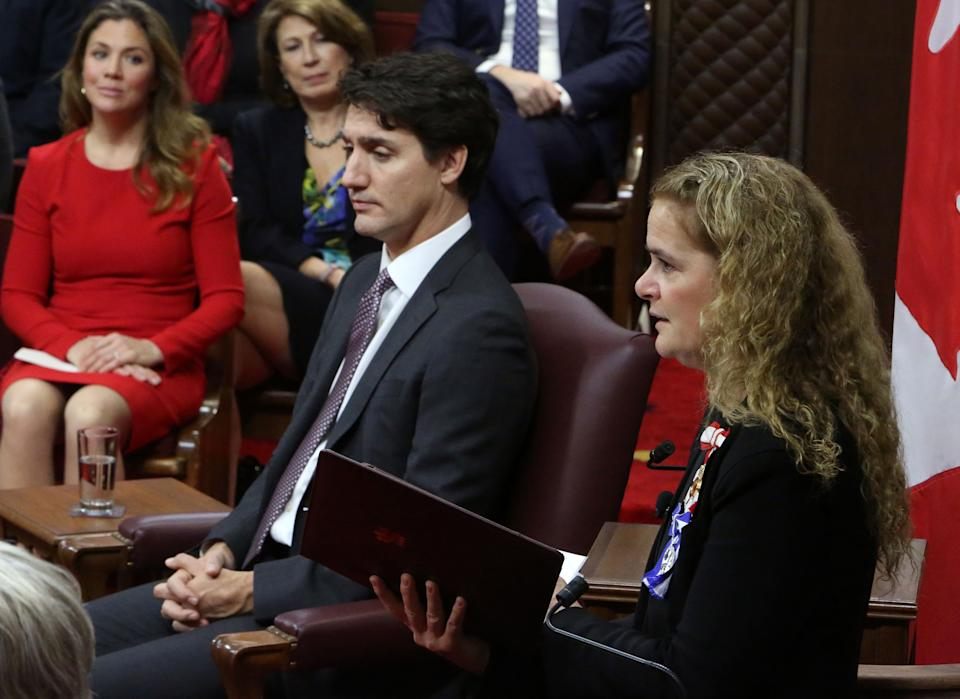 Sophie Gregoire and Prime Minister Justin Trudeau (C) look on as Governor General Julie Payette (L) delivers the Throne Speech in the Senate chamber on December 5, 2019 in Ottawa. (Photo by Fred Chartrand / POOL / AFP) (Photo by FRED CHARTRAND/POOL/AFP via Getty Images)