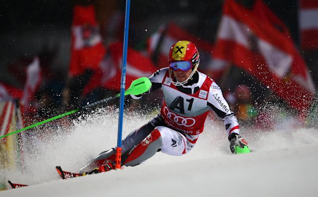 Marcel Hirscher of Austria competes during the first run of an alpine ski men's World Cup Slalom in Schladming, Austria, Tuesday, Jan. 28, 2014. (AP Photo/Giovanni Auletta)