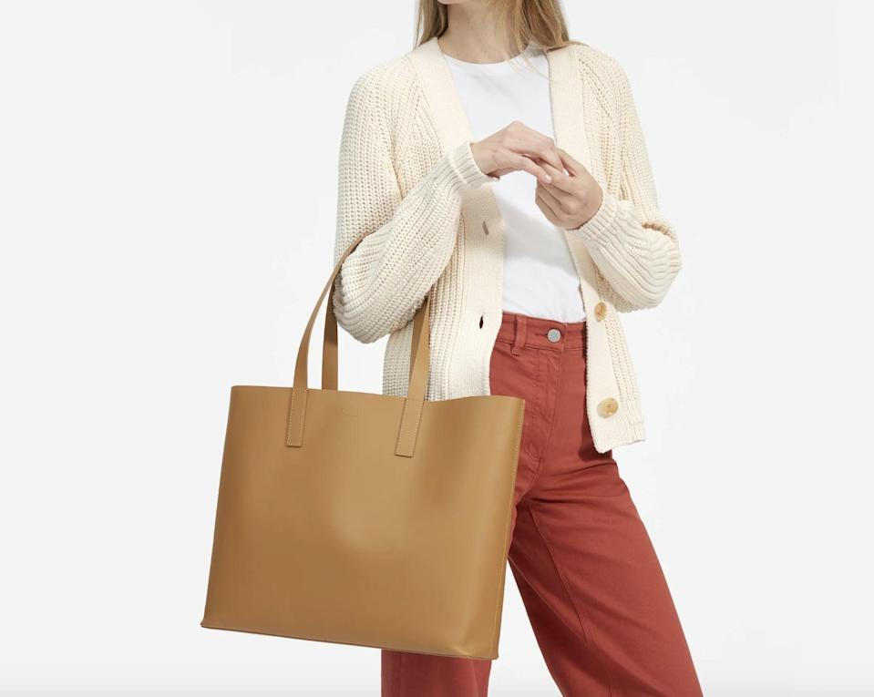"""<p>Made from 100 percent Italian leather, this <a href=""""https://www.popsugar.com/buy/Everlane-Day-Market-Tote-551707?p_name=Everlane%20The%20Day%20Market%20Tote&retailer=everlane.com&pid=551707&price=175&evar1=fab%3Aus&evar9=45623846&evar98=https%3A%2F%2Fwww.popsugar.com%2Ffashion%2Fphoto-gallery%2F45623846%2Fimage%2F45623850%2FEverlane-Day-Market-Tote&list1=shopping%2Caccessories%2Cbags%2Cworkwear%2Ceverlane&prop13=mobile&pdata=1"""" class=""""link rapid-noclick-resp"""" rel=""""nofollow noopener"""" target=""""_blank"""" data-ylk=""""slk:Everlane The Day Market Tote"""">Everlane The Day Market Tote</a> ($175) is of great quality and will last you for years. It also comes in three other shades.</p>"""