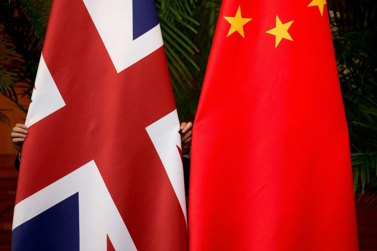 Beijing has praised a British diplomat who was filmed diving into a river in southern China to save a drowning student
