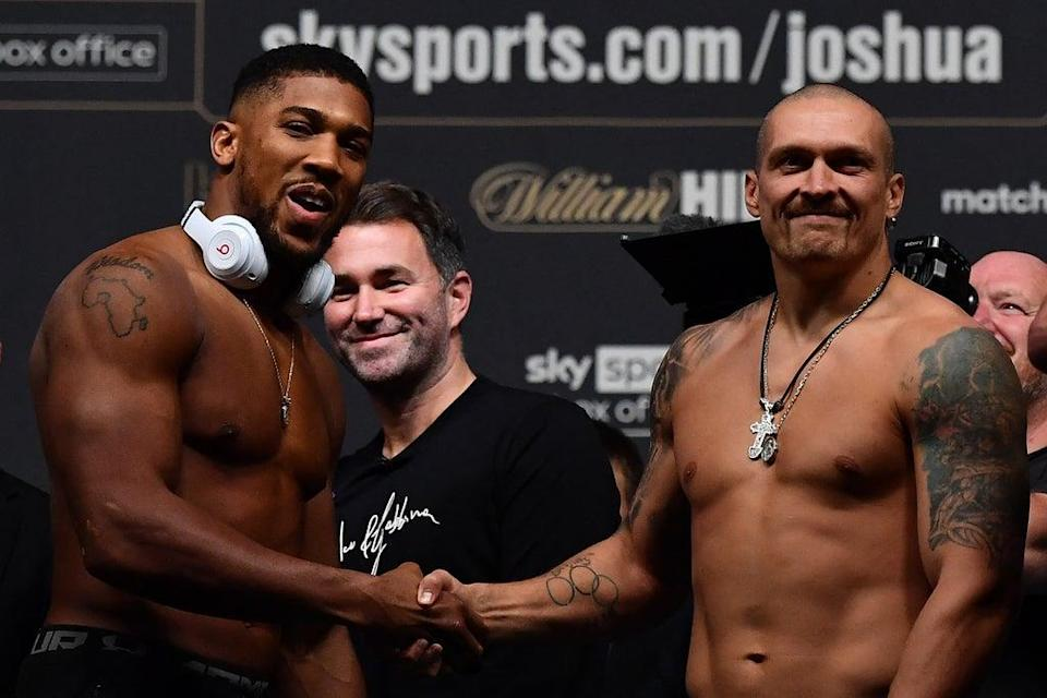 Anthony Joshua and Oleksandr Usyk remained respectful at the weigh-in  (AFP via Getty Images)