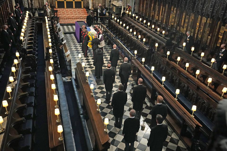 <p>Members of the Royal Family stand behind the Duke of Edinburgh's coffin as it arrives for his funeral in St George's Chapel. (PA)</p>